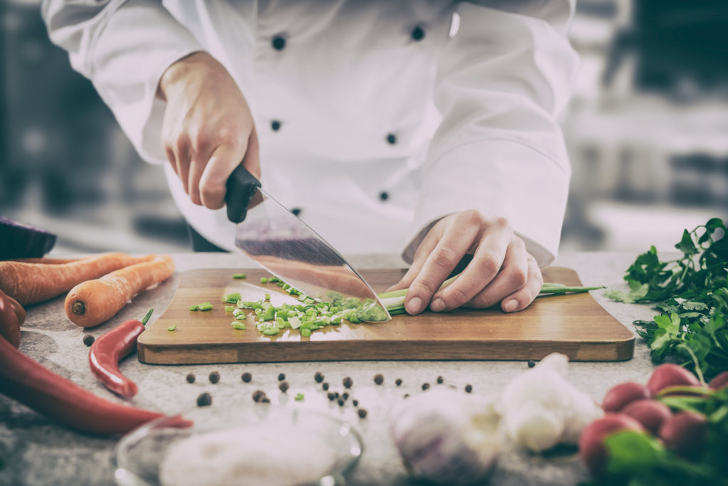 Praxis Insurance Associates - Workers Compensation - chef cooking food kitchen restaurant cutting cook hands hotel man male knife preparation fresh preparing concept